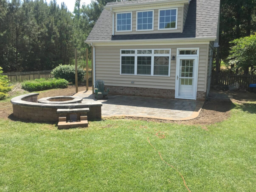 Fire Pit Patio with Water Fall by TSP Lawns & Landscapes of Yorktown VA